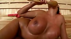 Emma masturbates her mature cunt in the sauna
