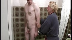 Blonde mature hottie seduced a young boy in the shower
