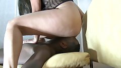 Sexy babe is sitting on this black face