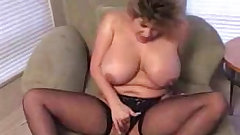 Mature babe Tori shows her giant natural boobs