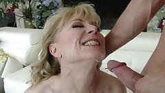 Busty mom blows best on younger cock