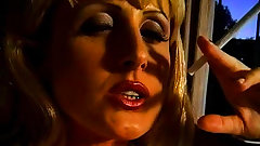 Mature blonde gets fingered while smoking