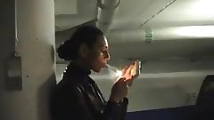 Charming smoking domina experienced in full leather in garage