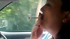 Slutty mom chain smoking while driving.