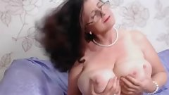 Lustful granny plays with her pussy in front of cam