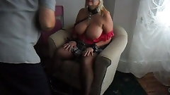 mature blonde cuffed with leash
