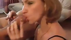 Sexy mature woman smoking and deep throating