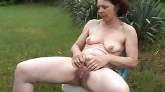 Hot mature masturbates in Garden