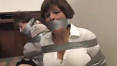 Two MILFs taped up in the office