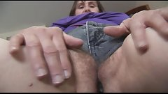 Busty hairy mature milf in tight shorts posing and stripping