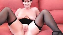 Classy granny in stockings shows off her big tits and fuckable pussy