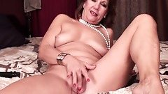 Mature Lady Brook playing with skeleton and her shaved pussy